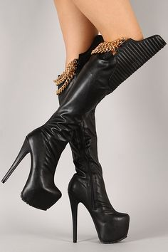 Hustle your way to the top with this striking thigh high boot! Featuring almond toe, asymmetrical shaft with quilted design at front, triple gold-tone draped chains detail at the back, concealed platform, and stiletto heel. Finished with cushioned insole, soft interior lining, and side zipper closure for easy on/off.
