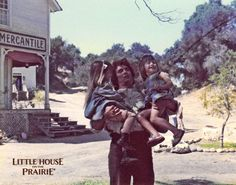 Michael Landon carrying the Greenbush twins on the set of Little House on the Prairie