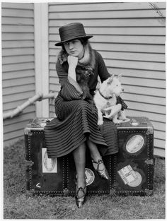I love everything about this photo. The dog, the trunk, the clothes and those shoes!