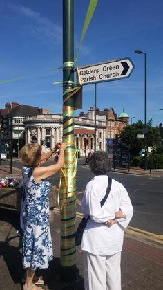 "Decorating the town in gold & green for #GoldersGreenTogether  ""We're here for the Jewish community"" say volunteers"