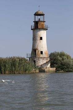 old unused lighthouse in Danube Delta, Sulina, Romania. Romania Tourism, Danube Delta, Safe Harbor, Beacon Of Light, Amazing Sunsets, Beautiful Sunrise, Water Tower, Abandoned Places, Towers