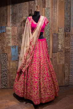 An exquisitely handcrafted fuchsia rose lehenga with a tonal blouse and champagne dupatta.To enquir 17 December 2017