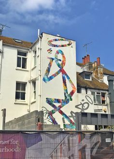 Brighton is one of the best places in the UK to see stunning graffiti. This is a tour of the best street art and tips for where to see the most vibrant examples. #brighton #graffiti #street #art #wall #murals #mazcan #glimmertwin #cosmo #sarson