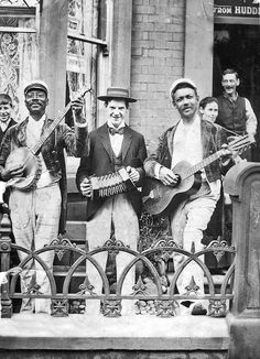 Street musicians, ca. 1900. Read the article for an amazing history of the concertina.