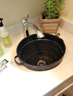 Vintage enamel pot re-purposed into laundry room sink