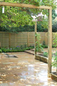 A timber pergola and Jacksons venetian fencing   #garden #design #timber