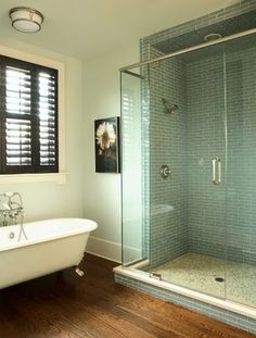 Glass and tile shower, plus old-school bathtub