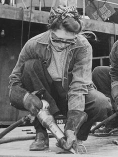 "detail of ""Chippers in a Shipyard"" [Shipbuilding. Three Women Working], 1942. - WWII propaganda photo USA, women war workers"