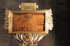 This is a photograph of the Titulus, a wooden fragment bearing a 1st century inscription.  This is probably a copy of the original sign that hung over Jesus of Nazareth upon His cross.