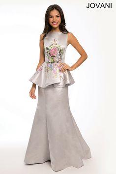 Satin Peplum Dress Gorgeous sleeveless floor length satin dress features a peplum skirt and floral print embellishment