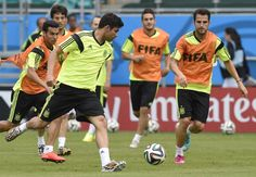 Spain's forward Diego Costa (L) vies with Spain's midfielder Cesc Fabregas (R) take part in a training session of the Spanish national football team at the Fonte Nova Arena in Salvador on June 12, 2014, on the eve of a Group B football match between Spain and Netherlands of the 2014 FIFA World Cup
