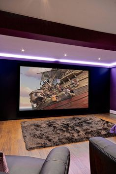 Family Cinema Room by Cinema Rooms. Rug by who knows...