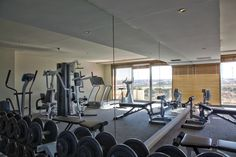 Gym and Fitness facilities at Lagoon Beach Hotel Fitness Facilities, Beach Hotels, Conference Room, Spa, Table, Weight Loss, Furniture, Home Decor, Decoration Home