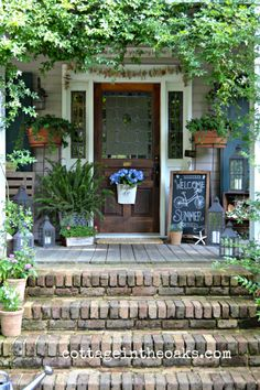 DIY Cottage Front Porch Decorating Ideas...this front porch is filled with lots of creative summer decorating tips.