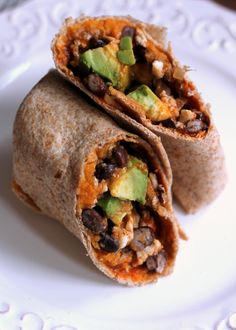 These healthy breakfast burritos are stuffed with sweet potatoes, black beans, egg whites, and avocado. They freeze well and are simple to heat up.