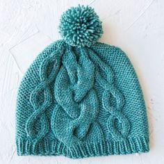 Big cable knit texture + pom poms = worth the hat hair. (FREE pattern in our bio link!)