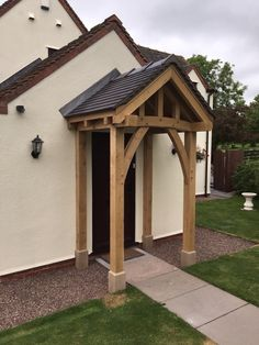 Here is a completed Green Oak Porch hand crafted and fitted by www.iaoakes.co.uk Porch Canopy Uk, Porch Uk, Front Door Porch, Front Porch Design, Door Canopy, House Front, Home Exterior Makeover, Backyard, Patio