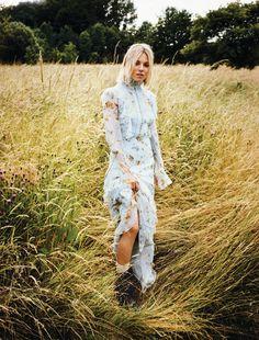Sienna Miller wears a floral Erdem silk dress and Frye  boots