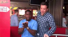 "First, Hart had to get past the sign that decides whether you're tall enough to ride. ""I'm a grown man!"" he yelled. 