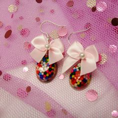 Adorable Pink Bow Sprinkle Earring!  Made with real colorful sprinkles, ribbon bow and lots of LOVE!!!   http://www.etsy.com/shop/JustAMood