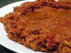 Muhammara is one of the most popular mezze dishes and one of the most distinct flavoured. This dish is originally from Aleppo, they love their peppers there. Even a type of pepper is named after the place Aleppo Pepper. (Syrian Foodie in London)