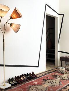 Black stripe, white molding-free walls, earthy rug. Those little bits.