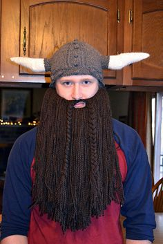My daughter's boyfriend sent me a picture of a knitted Viking helmet and said he would love one. After a little bit of research this is what I came up with. Contrary to his expression, he is very happy with it.
