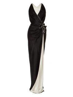 Made from fluid silk satin, the Temperley London Delilah Side Bow Dress has a cross over front, highlighted with three bows. Grecian style draping is both flattering and sophisticated while the glossy fabric adds a luxe feel to this sexy, laid back evening gown.           Fabric Composition: 100% Silk Satin        True to size.        Full length.        Model is 5ft 10 and is wearing a size 8.