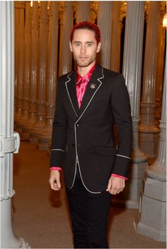 Actor Jared Leto attended LACMA 2015 Art and Film Gala in a contrast piped blazer, dark pink silk shirt and lion head brooch from Gucci Fall Winter 2015.