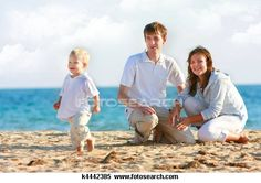 Stock Image of happy family on beach k4442385 - Search Stock Photos, Mural Pictures, Photographs, and Photo Clipart - k4442385.jpg