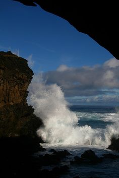 Waves Breaking Before a Cave