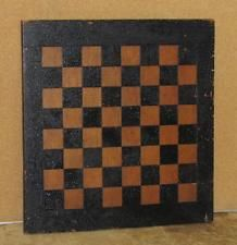 A GREAT EARLY PAINTED CHECKERBOARD GAME BOARD IN ITS ORIGINAL BLACK PAINT