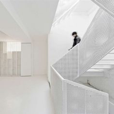 Arch Studio adds sculptural white staircase and glass roof extension to Beijing house