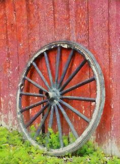 Wagon Wheel On Red Barn