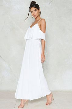 Chill out. The Relaxed to the Maxi Dress features a maxi, cold shoulder silhouette, ruffle detail at waist, and adjustable straps.