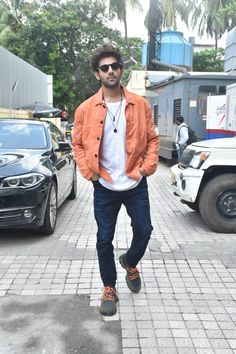 Kartik Aaryan's Super Casual Look Can Totally Be Your First Date Outfit Cute Actors, Handsome Actors, Indian Celebrities, Bollywood Celebrities, First Date Outfits, 22 November, Actor Picture, Orange Shirt, Celebrity Outfits