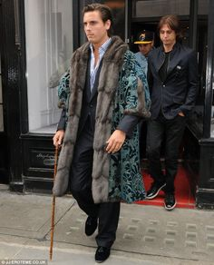 What do you look like! Scott Disick decided to channel Henry VIII in a fur coat and a wooden cane ( WTF this is a freakshow. More Kardashian madness.