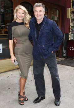 June 2013.  Lucky guy: Smiling Alec Baldwin cuddles up to Christie Brinkley