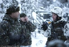 Prince Edward, wearing a rather stylish hat, listened avidly to the unit's tales...
