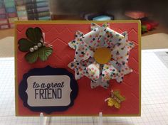 Stampin' Up! card made with the new (2015) Bow Builder punch and the  Pansy and Petite Petals punches. I also used the Simply Scored Borders Plate from Stampin' Up! and accented with Pearl Basic Jewels.
