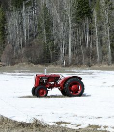 Tractor watching the snow melt