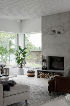 Living Room Simple Concrete Fireplace Design A fireplace is often a structure crafted from brick, st Concrete Fireplace, Fireplace Hearth, Home Fireplace, Living Room With Fireplace, Home Living Room, Living Room Designs, Fireplace Ideas, Apartment Living, Scandinavian Fireplace