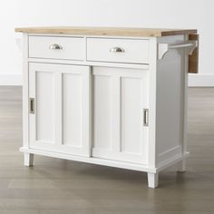 Shop Belmont White Kitchen Island. This kitchen island is equipped with 2 deep drawers, a sliding door cabinet with an adjustable shelf, and 2 towel bars. The 4 optional casters (sold separately) make it easy to move or store.