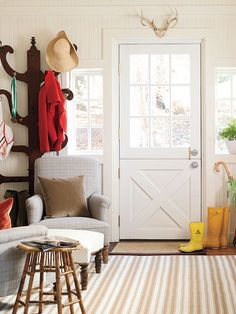 Family never uses the front door, so pay special attention to your back entry. A coat rack, umbrella stand, and doormat are easy additions to this functional space, but don't be afraid to mix in an area rug and a few easy chairs for comfort. (Photo: Annie Schlechter)
