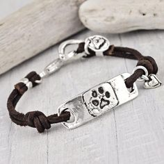 "Leather bracelet with ""I love my dawg"" on the back of a dog paw ID tag"