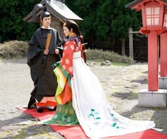 A couple dressed in heian robes, probably for their wedding.