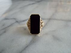 A Vintage Onyx Ring    CONTENT- 10kt Yellow Gold, Onyx    CONDITION- Good, no issues to note    ERA- late 1940s Art Deco    ABOUT- A great