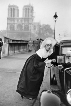 Paris, 1953 // ©Marc Riboud.  What is this sassy nun up to?