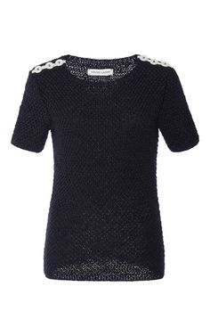 Designers Allyson Spencer and Vladimir Teriokhin deliver innovative, personality-filled sweaters entirely knit or crocheted by hand in New York. Crafted from silk, merino, and cashmere, this **Spencer Vladimir** top features white buttons along the shoulder for easy chic.