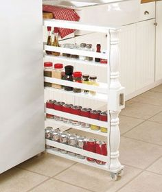 Slim Can and Spice Racks $30 or use 4 Ikea Bekvam for $4 each. These racks could also be placed in open space between fridge and wall, stacked 8 high.